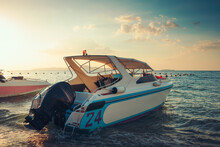 Speed Boat At The Sea Beach And Sunset.