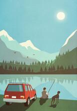 Man With Dog Fishing At Sunny Idyllic Mountain Lake