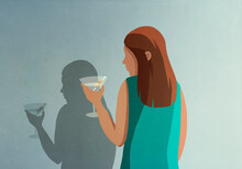 Shadow Of Woman With Martini At Wall