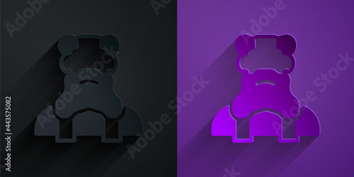 Paper cut Priest icon isolated on black on purple background Fotobehang