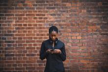 Female Athlete Sending A Text Message