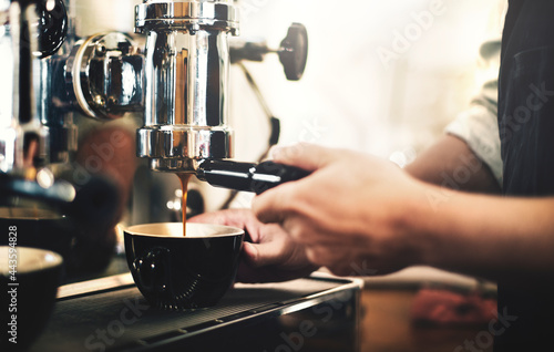Tela Barista working in a coffee shop