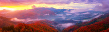 Scenic View Of Wooded Alps Mountains At Sunrise, Amazing Autumn Landscape With Mountain Ridge, Colorful Trees, Morning Mist And Cloudy Sky, Jamnik, Slovenia. Outdoor Travel Background