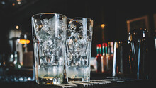 Ice Cube In An Empty Glass On A Bar Counterin Bar Or Pub