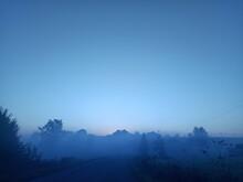 Thick Autumn Fog Rises At Sunrise Over The Ukrainian Village