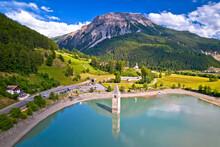Submerged Bell Tower Of Curon At Graun Im Vinschgau On Lake Reschen Alpine Landscape Aerial View,
