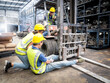 Leinwandbild Motiv Female workers are banning cargo drivers from continuing to drive due to an accident, a male worker's leg gets stuck in a forklift's wheel while working inside an auto-parts warehouse.