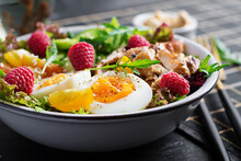 Grilled Chicken Meat And Fresh Vegetable Salad Of Tomato, Cucumber, Egg, Lettuce And Raspberry. Ketogenic Diet. Buddha Bowl Dish On Dark Background