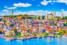 Touristic Sightseeing Ships In Golden Horn Bay Of Istanbul And Mosque With Sultanahmet District Against Blue Sky And Clouds. Istanbul, Turkey During Sunny Summer Day.