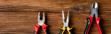 Top View Of Pliers And Wire Cutters On Wooden Surface, Labor Day Concept, Banner