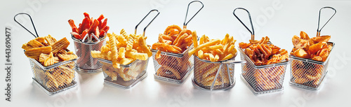 Fotografie, Obraz Metal baskets with French fries on white background