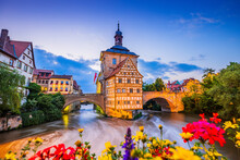 Bamberg, Germany. Town Hall Of Bamberg (Altes Rathaus) With Two Bridges Over The Regnitz River. Upper Franconia, Bavaria.