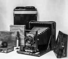 Folding Bed Plate Medium Format Vintage Film Camera. Old Bellows Photo Camera Isolated On White Background