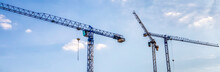 Banner Of Construction Tower Cranes With Cabins In A Blue Sky. Industry Concept