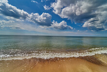 Panoramic Dramatic Sunset Sky And Tropical Sea At Dusk. Beach Sand, Sea And Blue Sky With Clouds