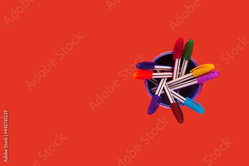 Fototapeta colored pens in a penholder. office accessories
