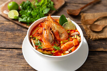 Tom Yam Kung ,Prawn And Lemon Soup With Mushrooms, Thai Food In White Bowl Top View