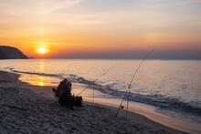 Unrecognizable Fishermen Catching Fish In Sea