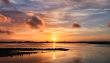 Sunset Over The Sea At Salt Flats In Aveiro, Portugal.