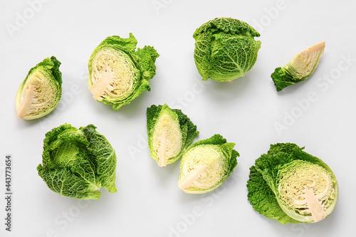 Pieces of fresh savoy cabbage on white background Fototapeta