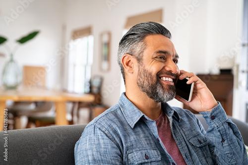 Fotografie, Obraz Happy mid indian man talking on phone