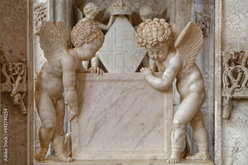 BOURG-EN-BRESSE, FRANCE, June 29, 2021 : Angels on graves in gothic Brou monastery church
