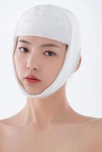 Beautiful Woman Look In The Mirror Wearing A Bandage