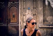 Woman In Front Of Door