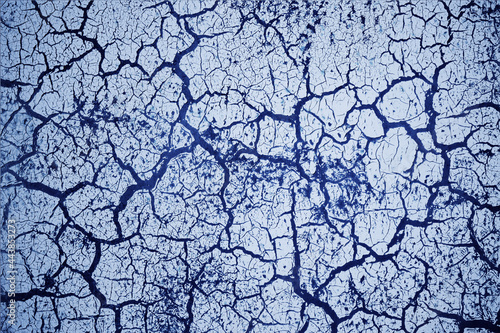 Foto Abstract blue textured grunge background with cracks for your design