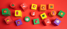 Festive Banner With Soft Toys Multicolored Children's Cubes With Xmas Symbols Above On Them On Red Background.