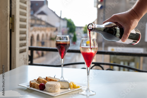 Canvas Drinking of Kir Royal,  French aperitif cocktail made  from creme de cassis topp