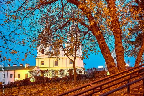 Orthodox White Church near the park in the evening Fototapeta