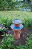 Bird waterer made of flower pots in a garden