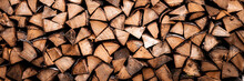 Textured Firewood Background Of Chopped Wood For Kindling And Heating The House. A Woodpile With Stacked Firewood. The Texture Of The Birch Tree. Banner