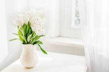 Bouquet Of White Tulips In White Ceramic Jug On Table. Spring Concept