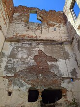 Old And Ruined Building In The Daytime In Summer.
