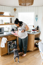 A Pregnant Woman Cooking Breakfast A Small Kitchen