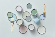 Different Lids Of Paints And Brushes