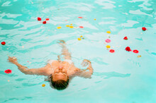 Woman Floating With Flowers
