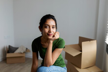 Portrait Of Indian Woman Looking At Camera At New Apartment