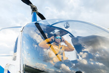 Helicopter Pilot With Sunglasses Preparing To Fly