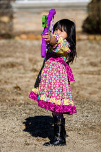 Girl Shooting A Play Bow And Arrow