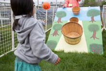 Girl Playing A Carnival Game