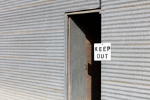 Keep Out Sign Near Doorway Of Grain Silo