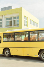 Yellow Bus In Front Of The Building