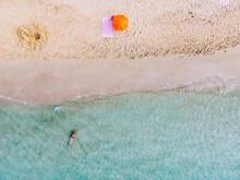 A Woman Bathing On The Beach