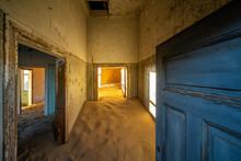 Abandoned Building Being Taken Over By Encroaching Sand In The Ghost Town Of Kolmanskop Near Luderitz, Namib Desert, Namibia.