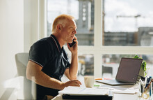 Senior Businessman Talking On Phone