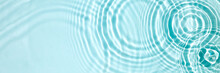 Blue Water Texture, Blue Mint Water Surface With Rings And Ripples. Spa Concept Background. Flat Lay, Copy Space.