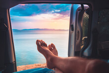 Young Bare Foot Man Looks The Sea From His Van. Mediterranean Summer Holiday. Relax Vacation Enjoying Sunset In The Ocean.